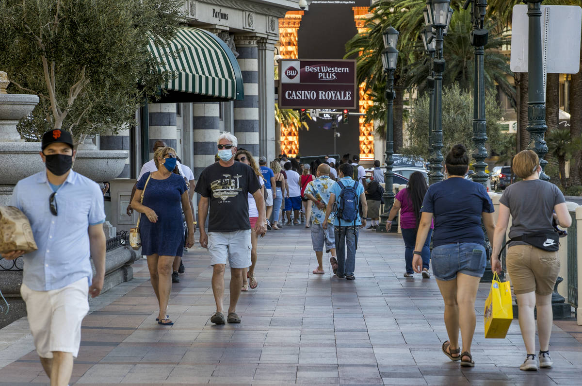 Visitors wander along the Strip on Friday, August 7, 2020, in Las Vegas. The Las Vegas Conventi ...