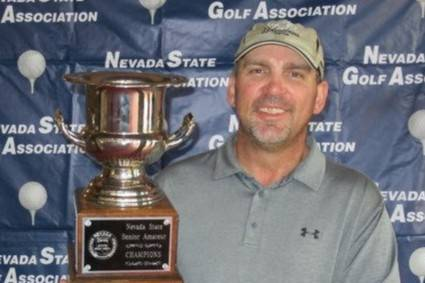 Joe Peroglio holds the championship trophy after winning the Nevada State Senior Amateur at Red ...