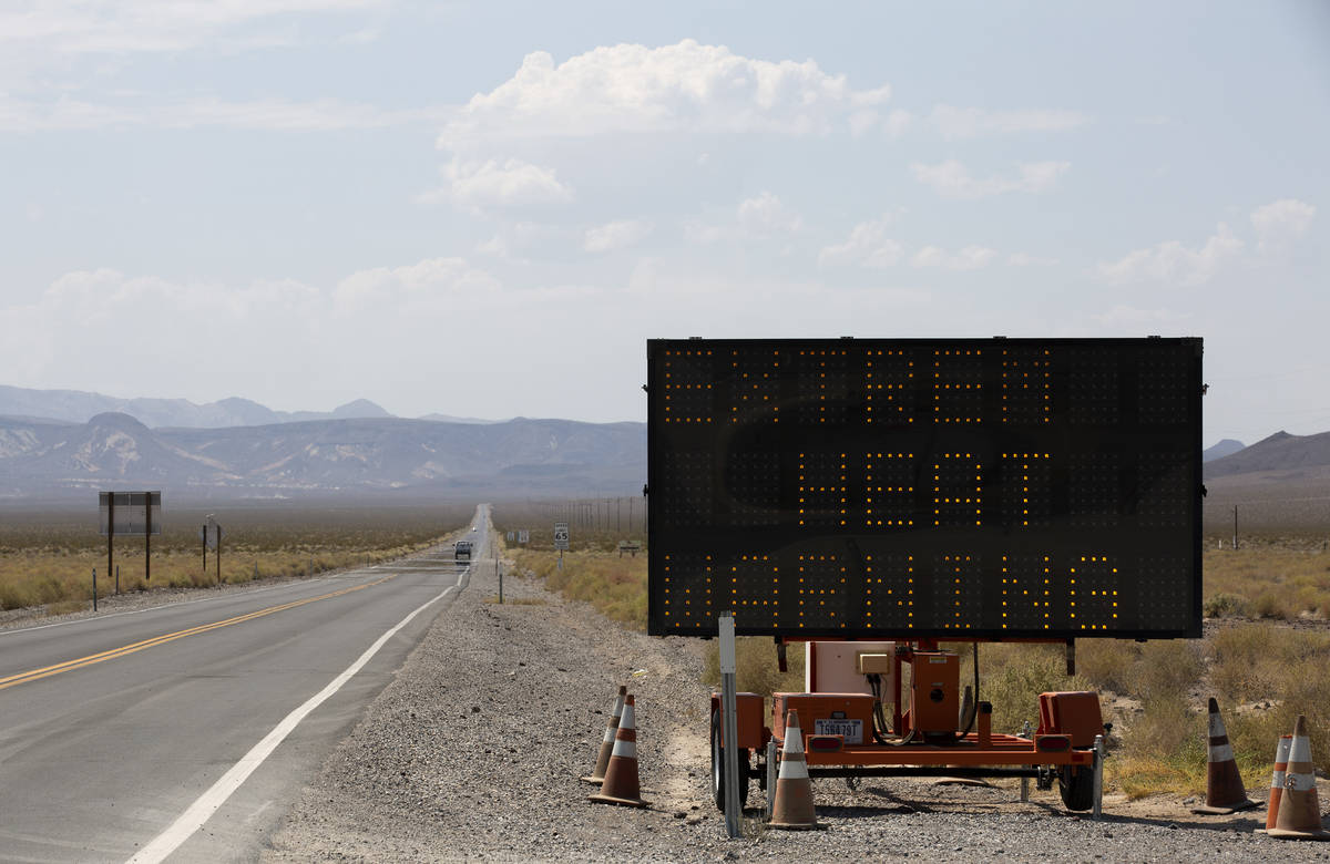 The road into Death Valley National Park features a sign warning of excessive heat on Monday, A ...