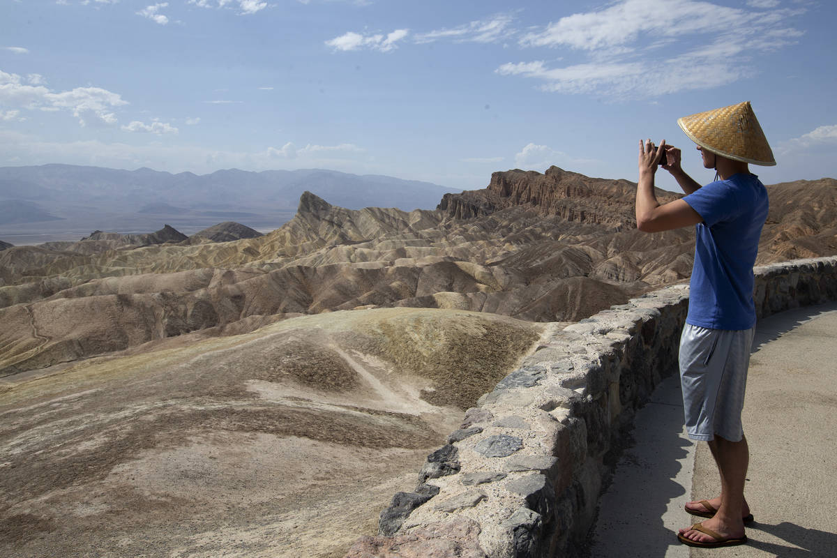 Peter Vukasin snaps a photo at Zabriskie Point in Death Valley National Park in California as t ...