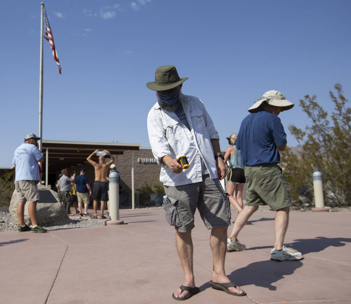 Mark Lehman, data manager at Mojave Desert Network, takes the temperature of the ground outside ...