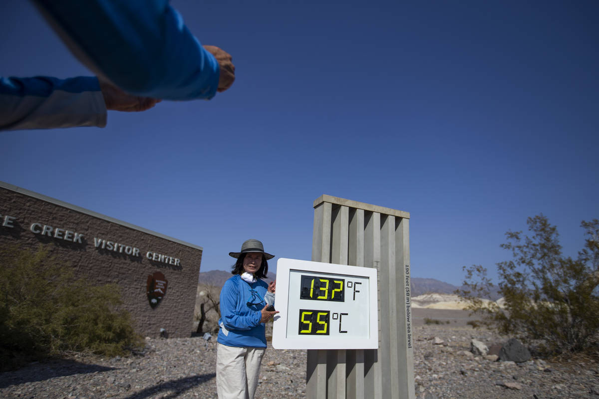 Margie Owen poses for a photo beside the thermometer outside Furnace Creek Visitor Center in De ...