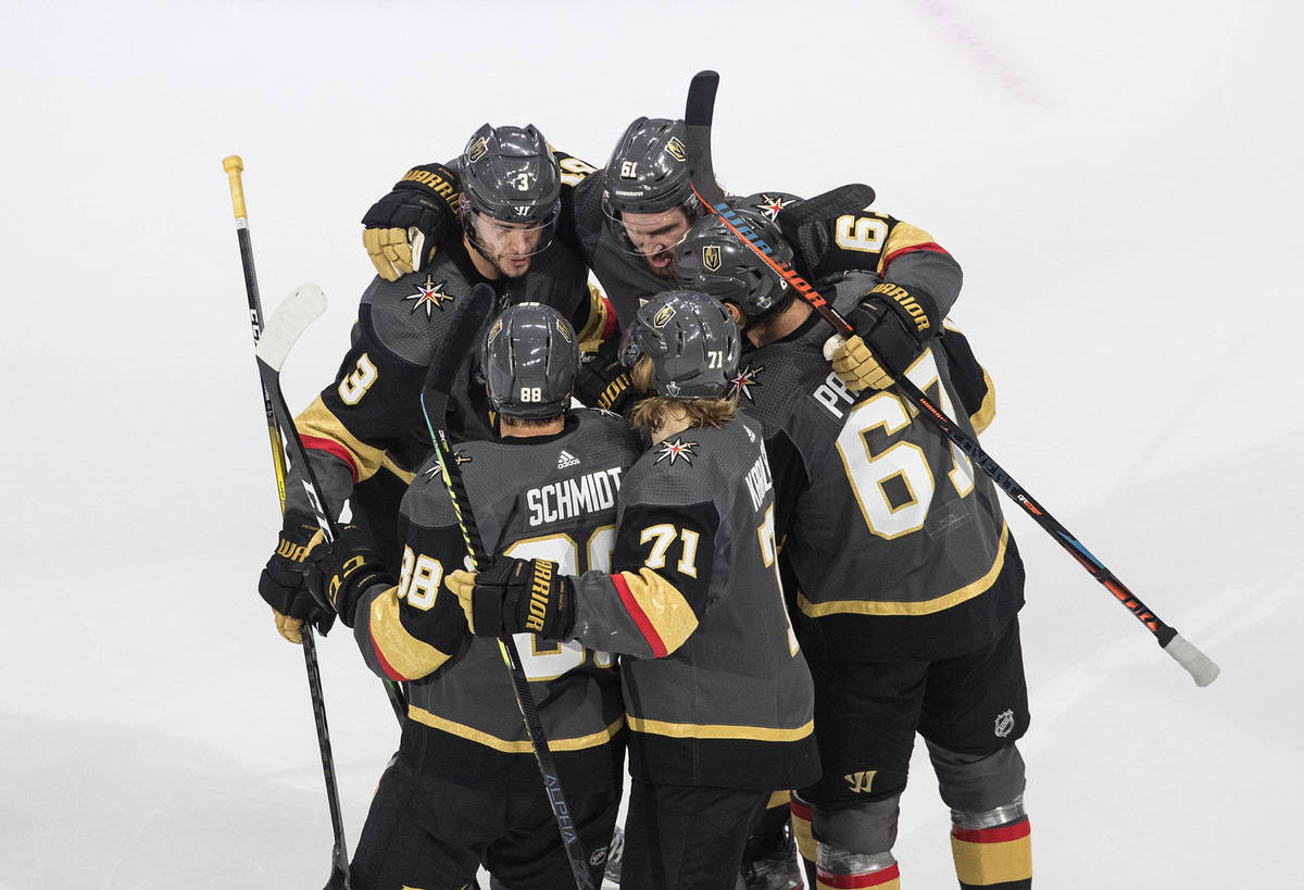Vegas Golden Knights celebrate a goal against the Chicago Blackhawks during the first period of ...