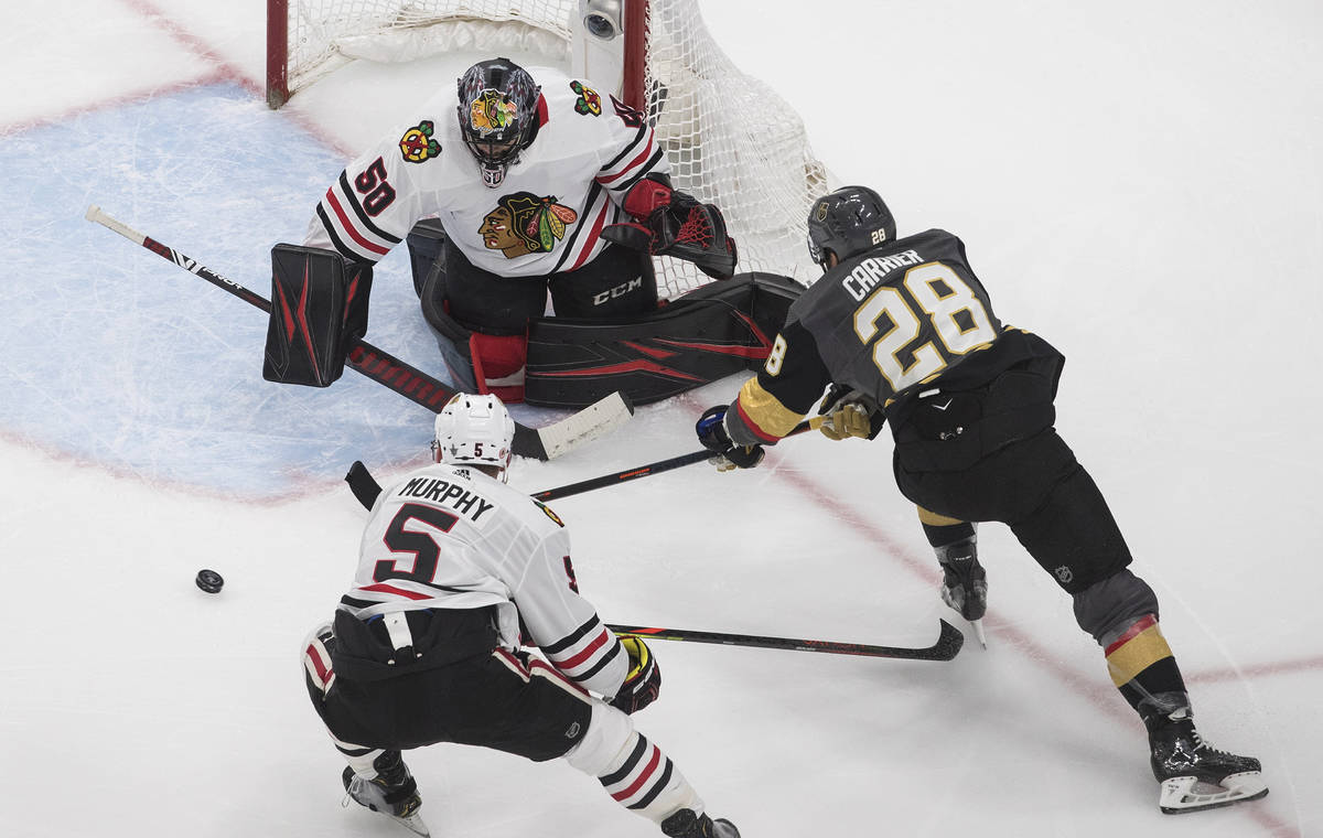 Vegas Golden Knights' William Carrier (28) is stopped by Chicago Blackhawks goalie Corey Crawfo ...