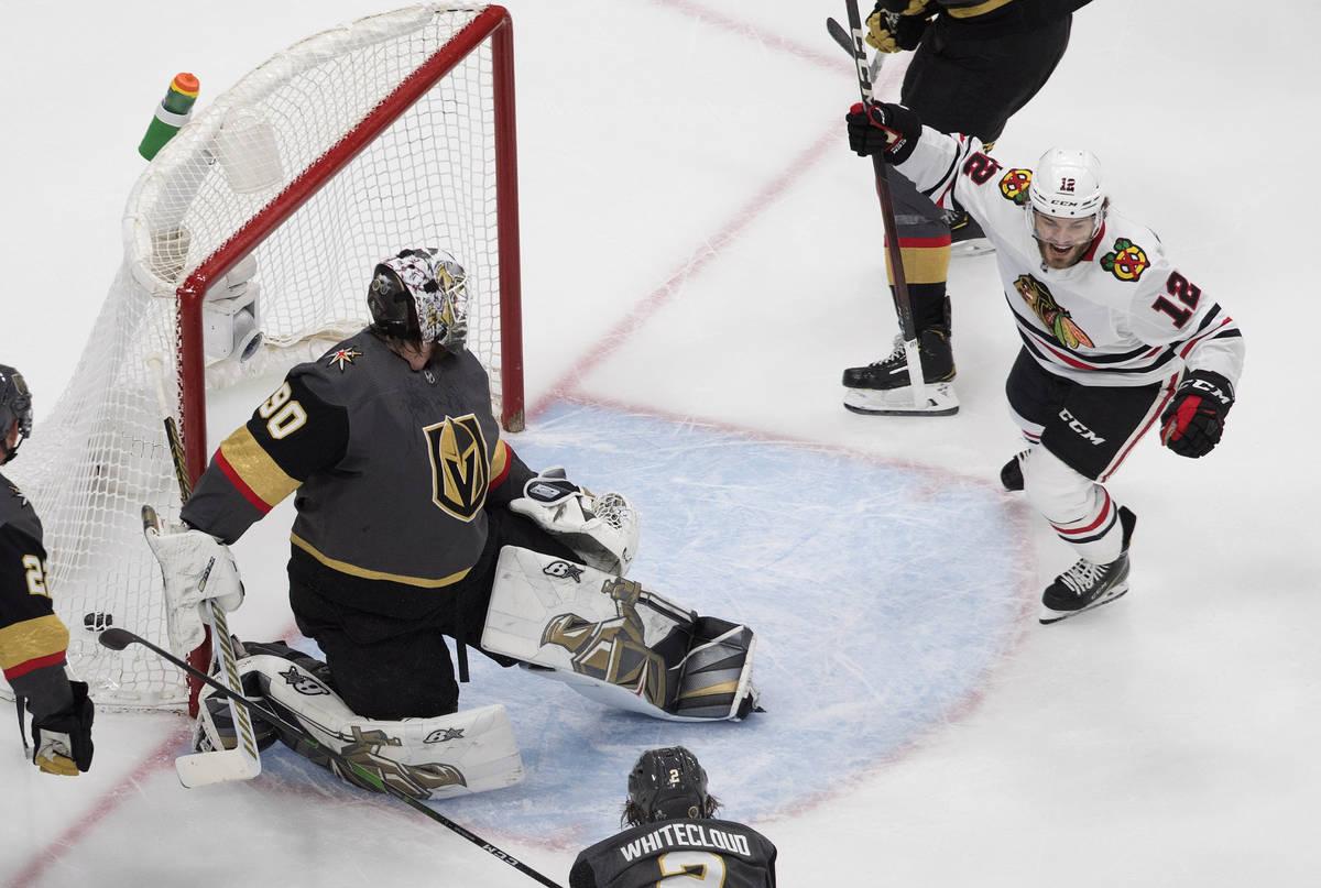 Vegas Golden Knights goalie Robin Lehner (90) is scored on by Chicago Blackhawks' Alex DeBrinca ...