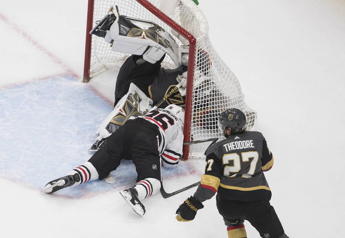 Chicago Blackhawks' Robin Lehner (16) crashes against Vegas Golden Knights goalie Robin Lehner ...