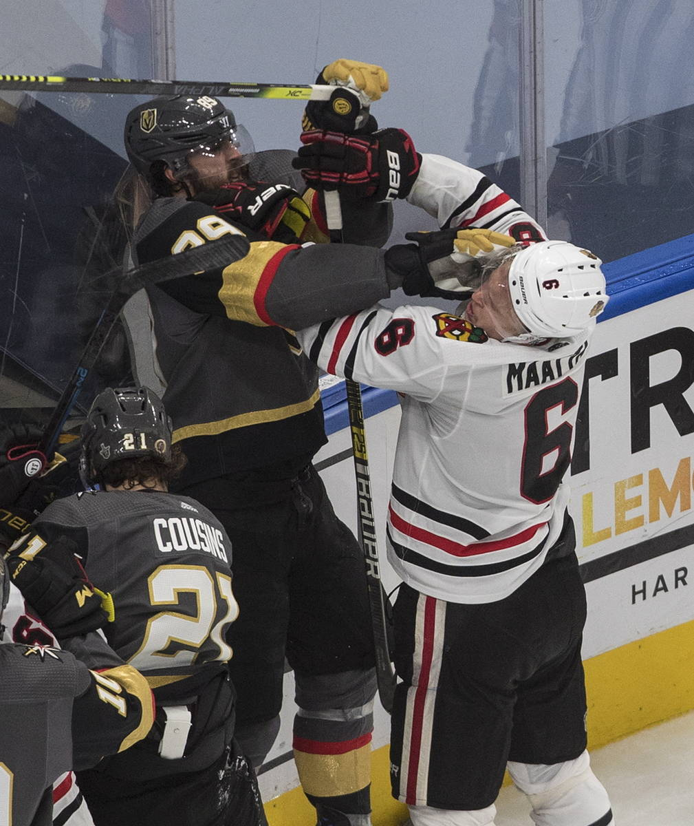 Vegas Golden Knights' Alex Tuch (89) and Chicago Blackhawks' Olli Maatta (6) rough it up during ...