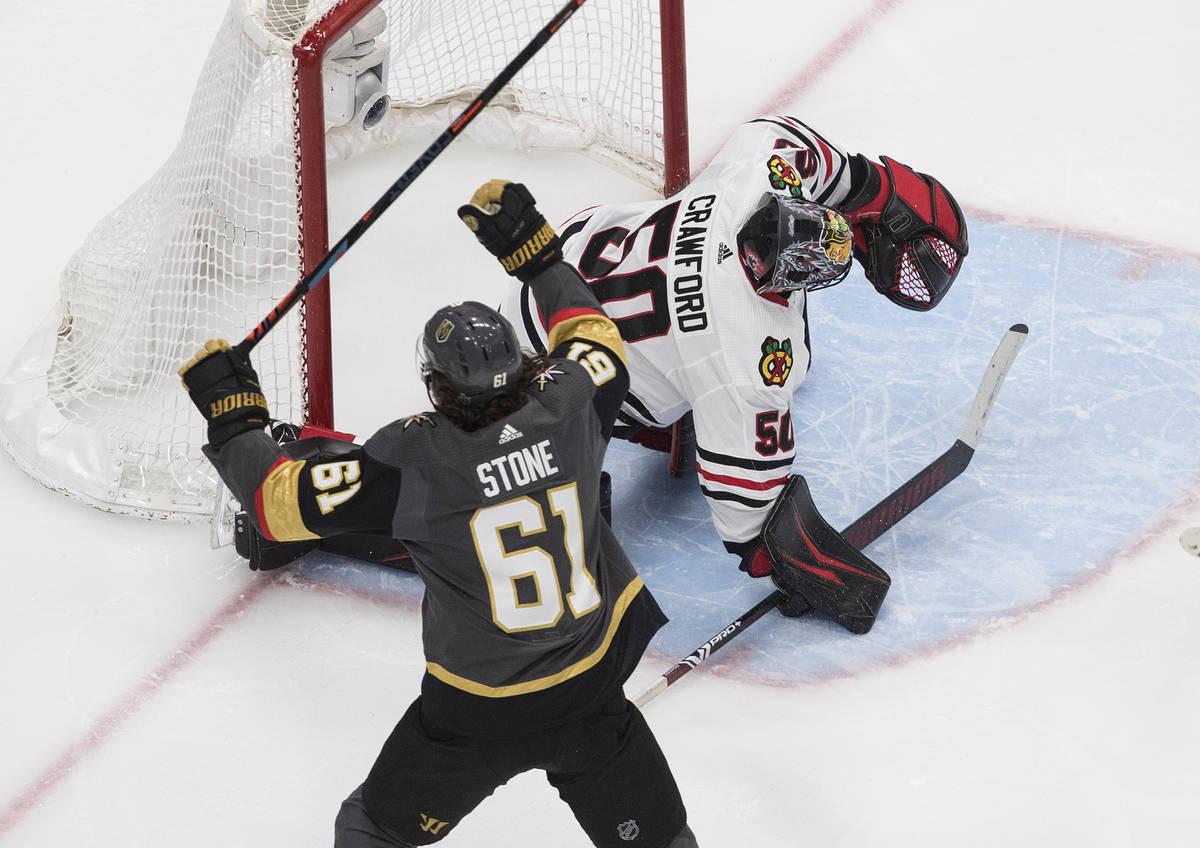 Vegas Golden Knights' Mark Stone (61) celebrates a goal on Chicago Blackhawks goalie Corey Craw ...