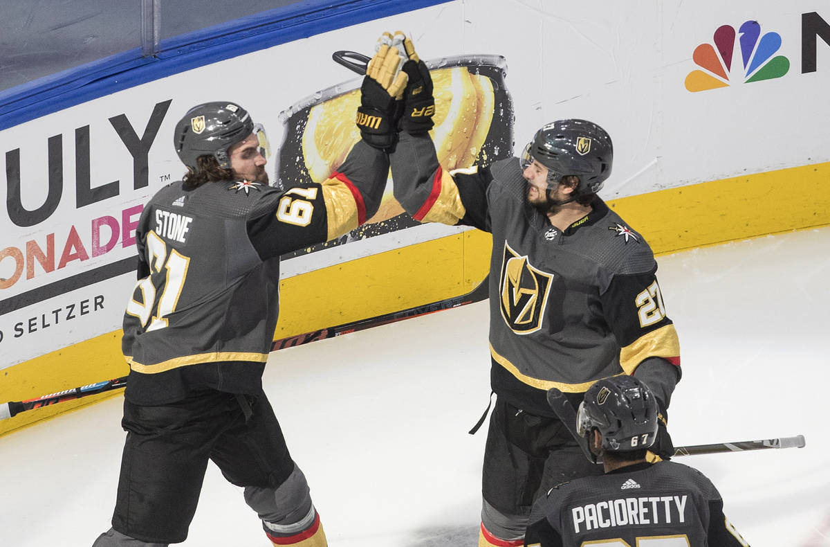 Vegas Golden Knights' Mark Stone (61) and Shea Theodore (27) celebrate a goal against the Chica ...