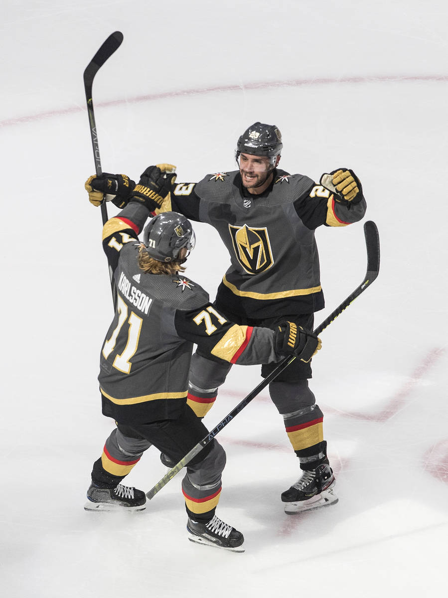 Vegas Golden Knights' Alec Martinez (23) and William Karlsson (71) celebrate a goal against the ...