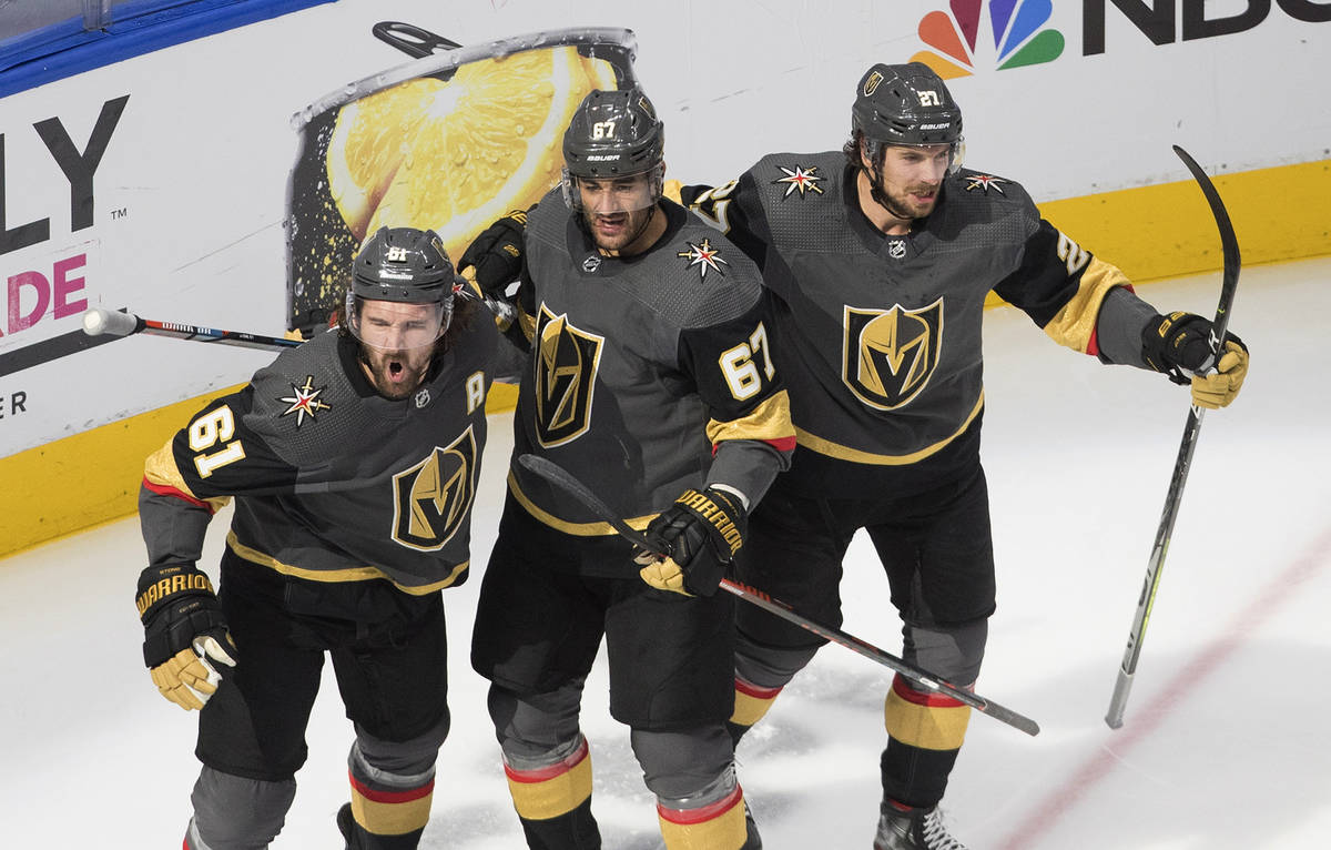 Vegas Golden Knights' Mark Stone (61), Max Pacioretty (67) and Shea Theodore (27) celebrate a g ...