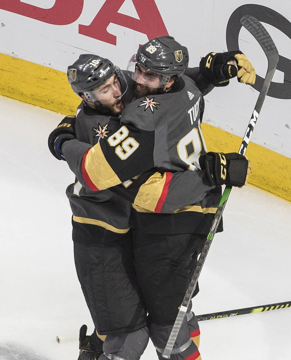 Vegas Golden Knights' Nicolas Roy (10) and Alex Tuch (89) celebrate a goal against the Chicago ...