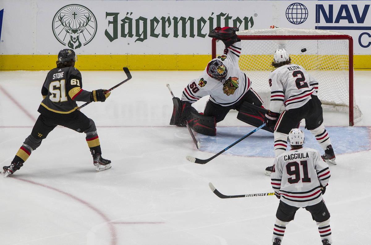 Vegas Golden Knights' Mark Stone (61) scores on Chicago Blackhawks goalie Corey Crawford (50) a ...