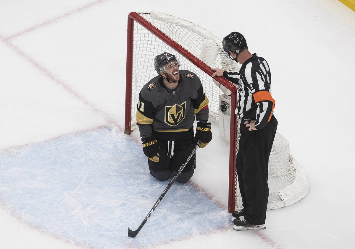 Vegas Golden Knights' Jonathan Marchessault talks with an official after crashing into the net ...