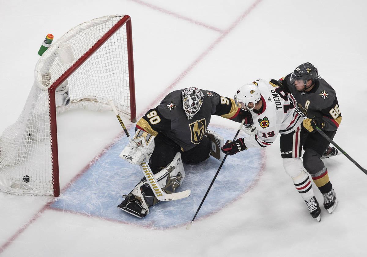 Vegas Golden Knights goalie Robin Lehner (90) gives up a goal to Chicago Blackhawks' Jonathan T ...
