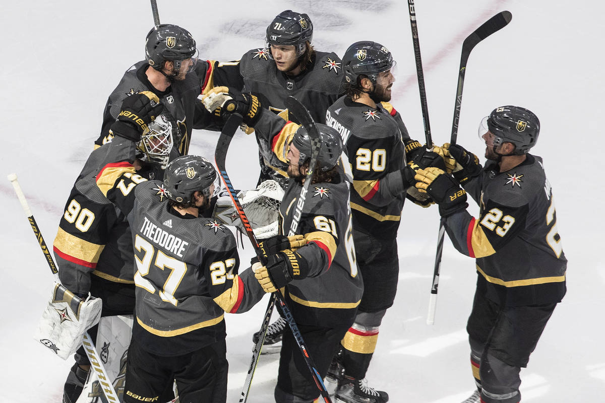 The Vegas Golden Knights celebrate a win over the Chicago Blackhawks in Game 5 of an NHL hockey ...