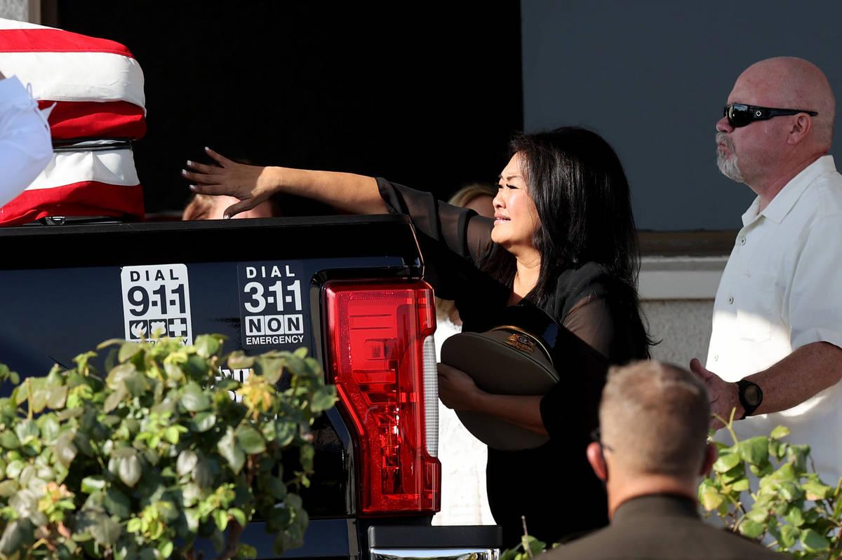 Minddie Lloyd reaches out at the casket of her husband, Metropolitan Police Department Lt. Erik ...