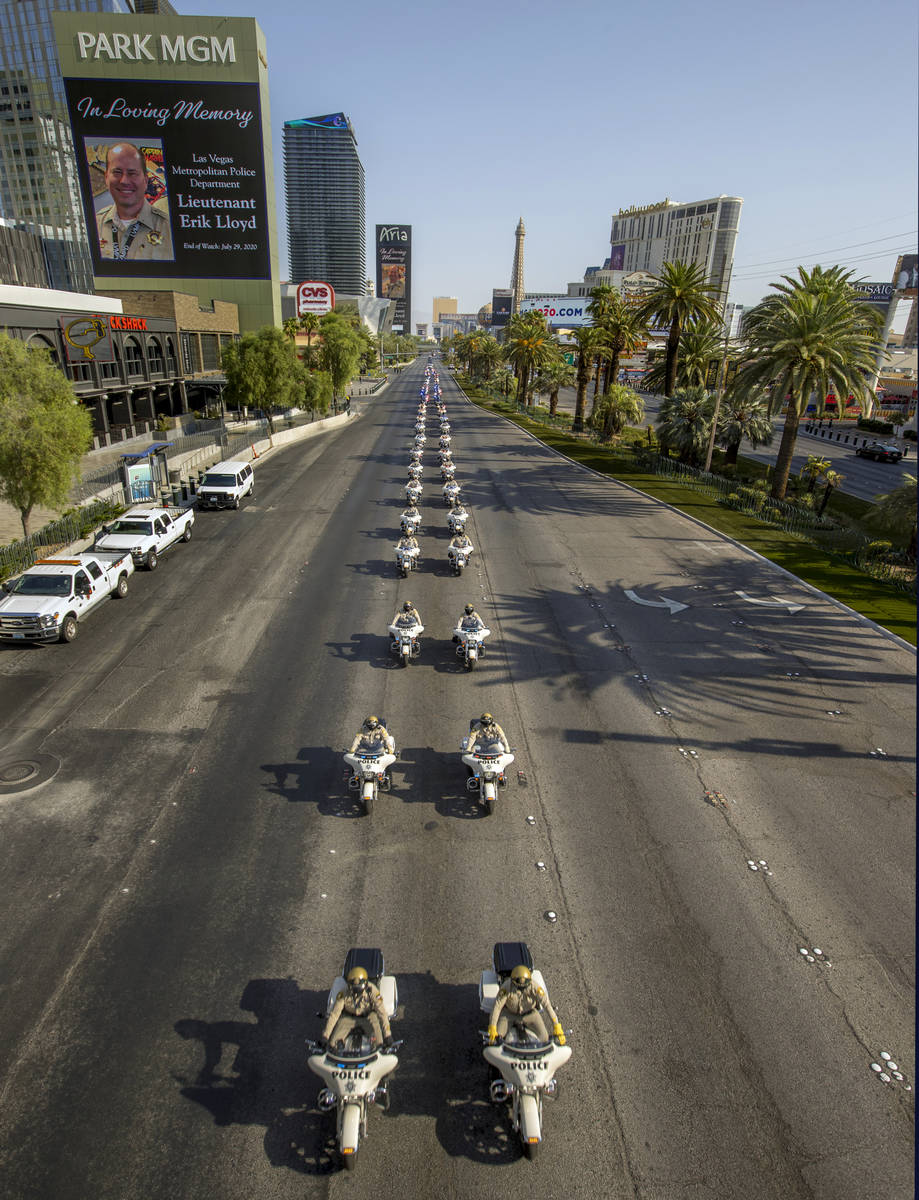 Motorcycle officers lead an emergency vehicles escort during a funeral procession for Metro Lt. ...