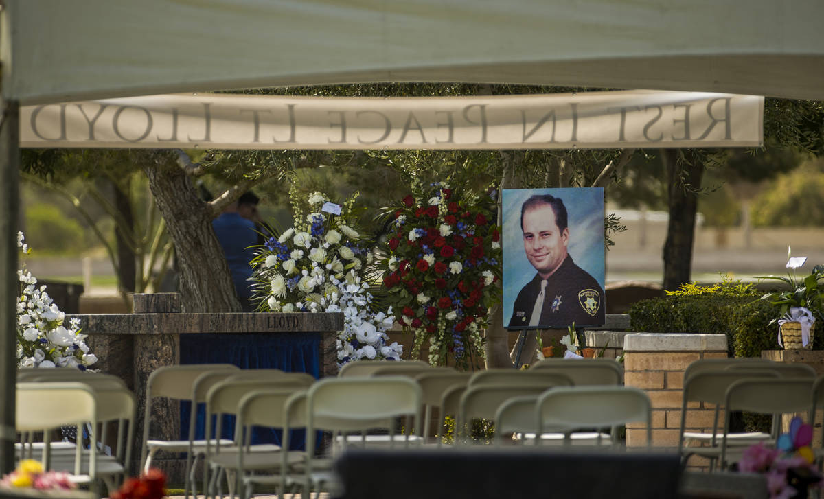 A portrait awaits mourners before a burial service for Metro Lt. Erik Lloyd at the Palm Northwe ...