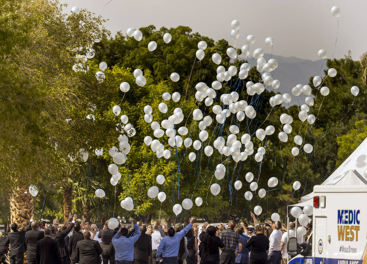 Balloons are launched commencing a burial service for Metro Lt. Erik Lloyd at the Palm Northwes ...