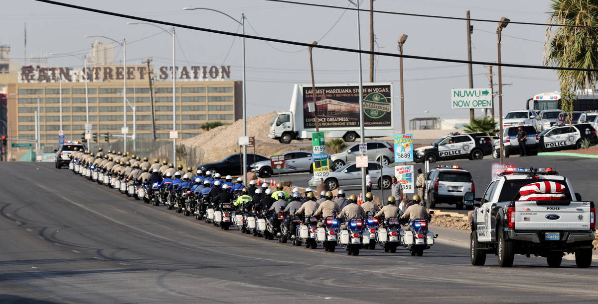 The casket for Metropolitan Police Department Lt. Erik Lloyd leaves Palm Downtown Mortuary &amp ...