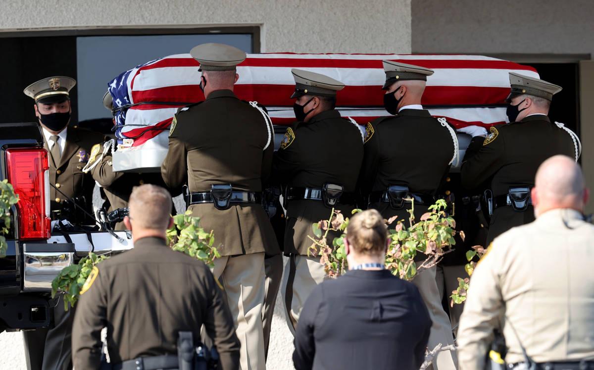 Honor guard members load the casket of Metropolitan Police Department Lt. Erik Lloyd at Palm Do ...