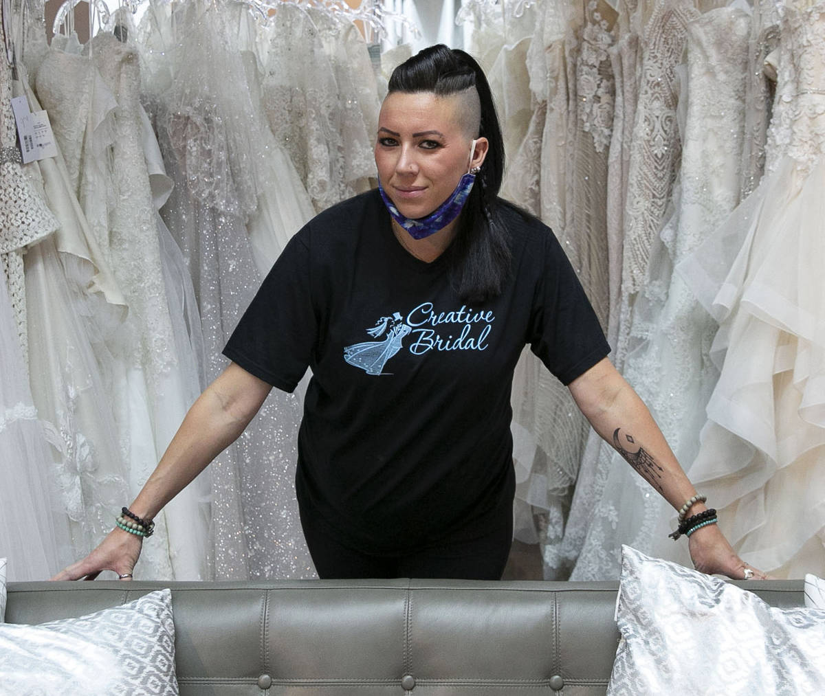 Veronica Markowsky, co- owner of Creative Bridal Wear, poses for a photo at her store on Friday ...