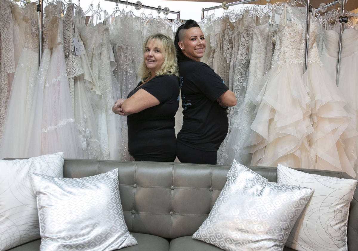 Kelly Bain, left, and Veronica Markowsky, owners of Creative Bridal Wear, pose for a photo at t ...