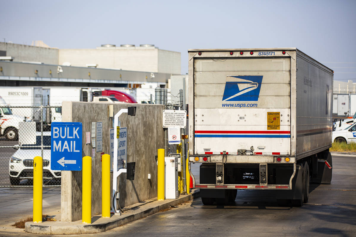 A truck arrives at the U.S. Postal Service center at 1001 E. Sunset Road in Las Vegas on Thursd ...