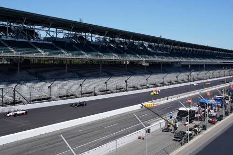 Cars drive down the main straight-a-way during the final practice session for the Indianapolis ...