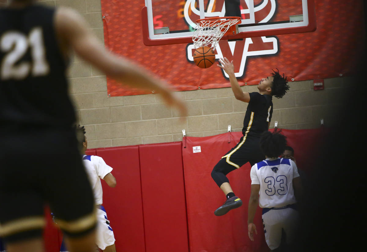 Clark's Frankie Collins (1) dunks against Desert Pines during the first half of a Class 4A stat ...