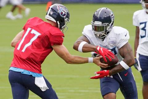 Tennessee Titans quarterback Ryan Tannehill (17) hands off to running back Derrick Henry during ...