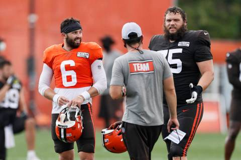 Cleveland Browns quarterback Baker Mayfield (6) and guard Joel Bitonio (75) talk with head coac ...