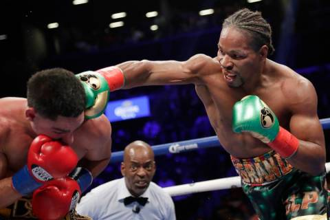 In this Sept. 8, 2018, file photo, Shawn Porter, right, punches Danny Garcia during the eighth ...