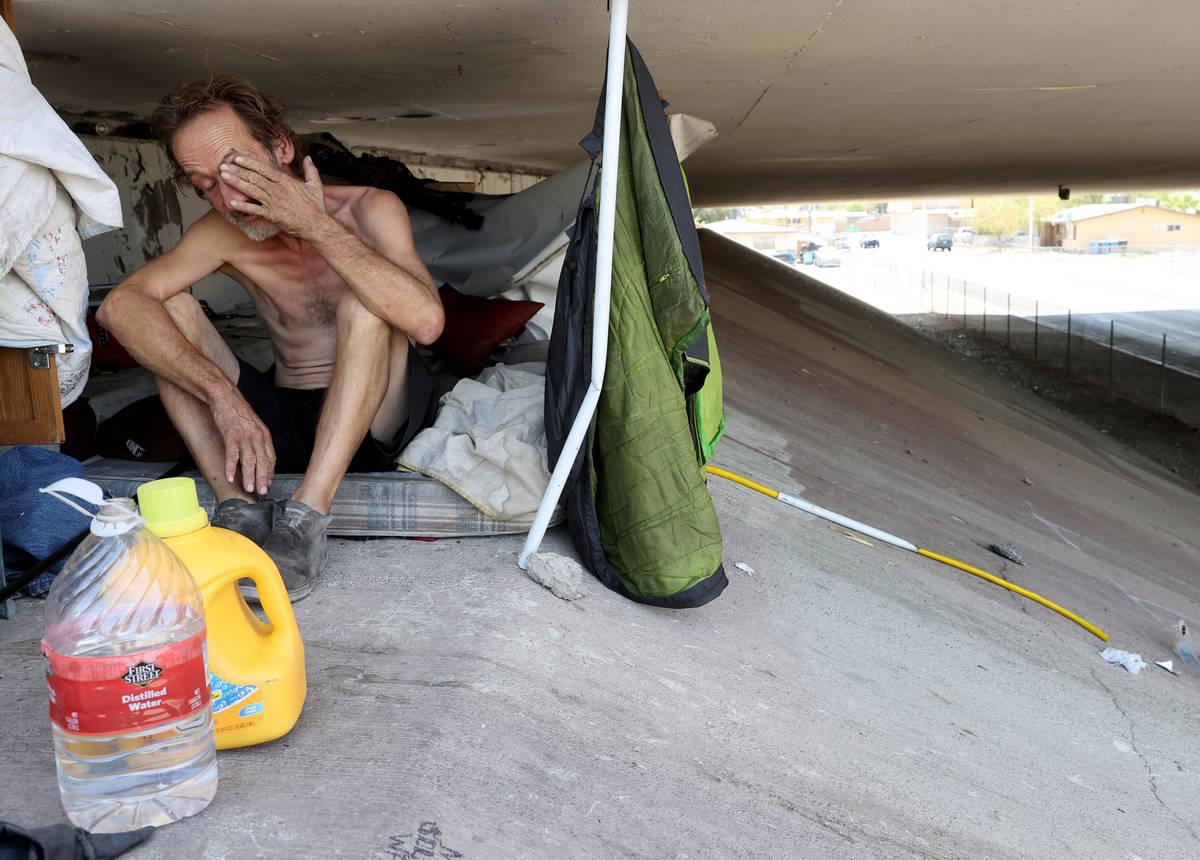 Aaron DeWees, 52, stays cool under a freeway overpass on 21st Street near Elm Avenue in Las Veg ...