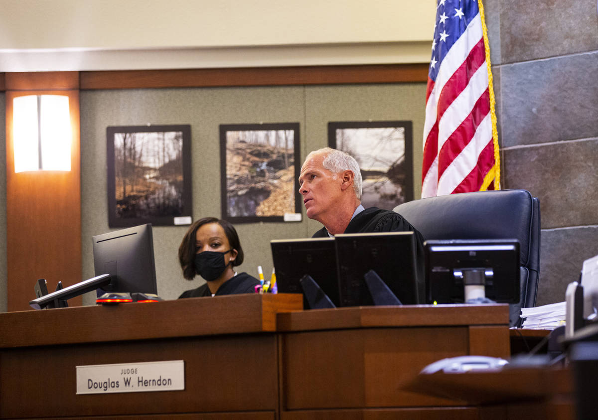 District Judge Douglas Herndon looks at messages from Lauren Prescia, accused of driving under ...