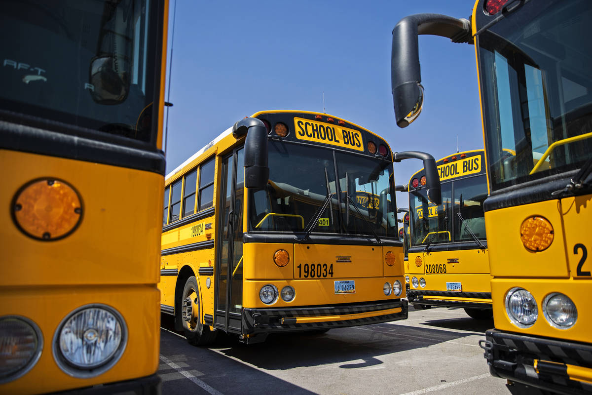Rows of busses lay dormant at Northwest Transportation Facility on Thursday, Aug. 20, 2020, in ...