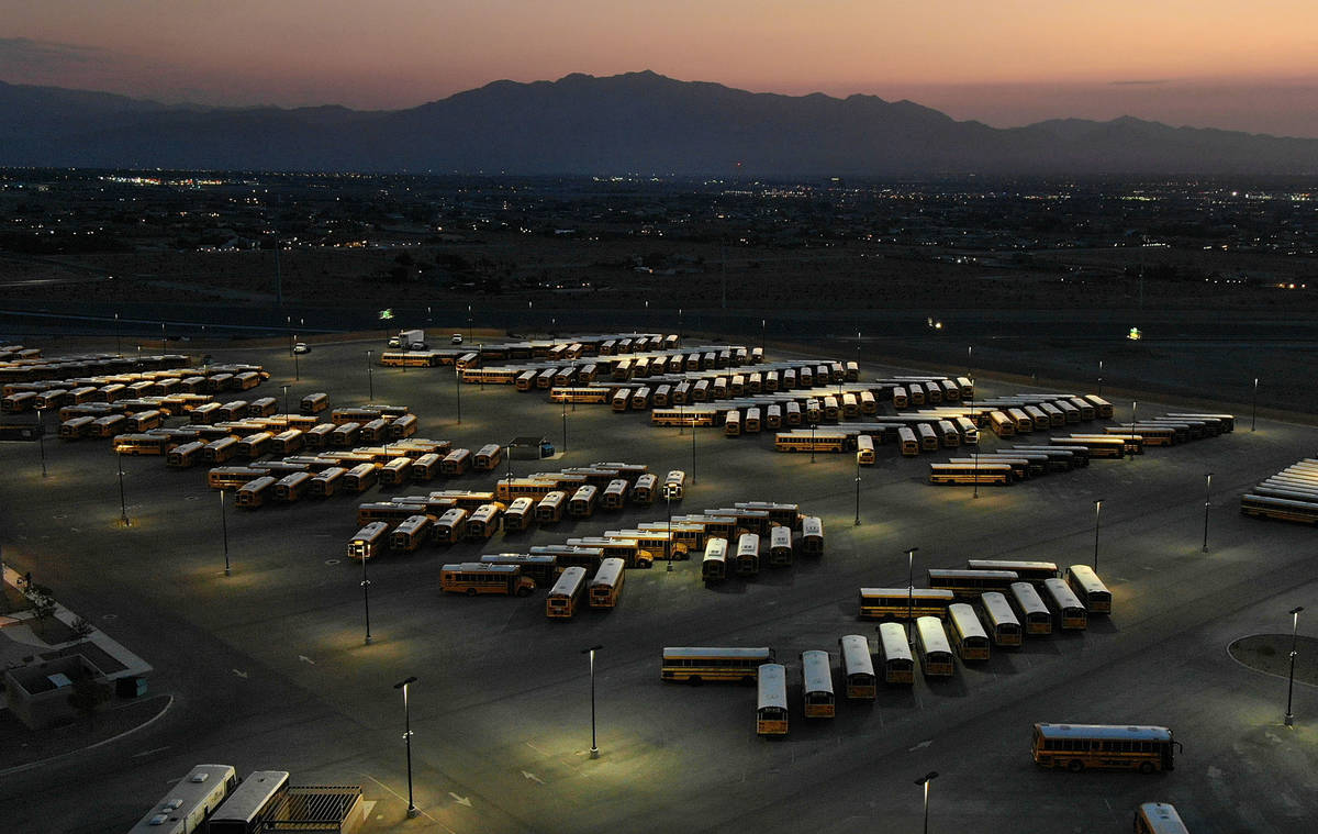 Dawn at the Clark County School District bus yard at the CCSD Northwest Transportation Facility ...