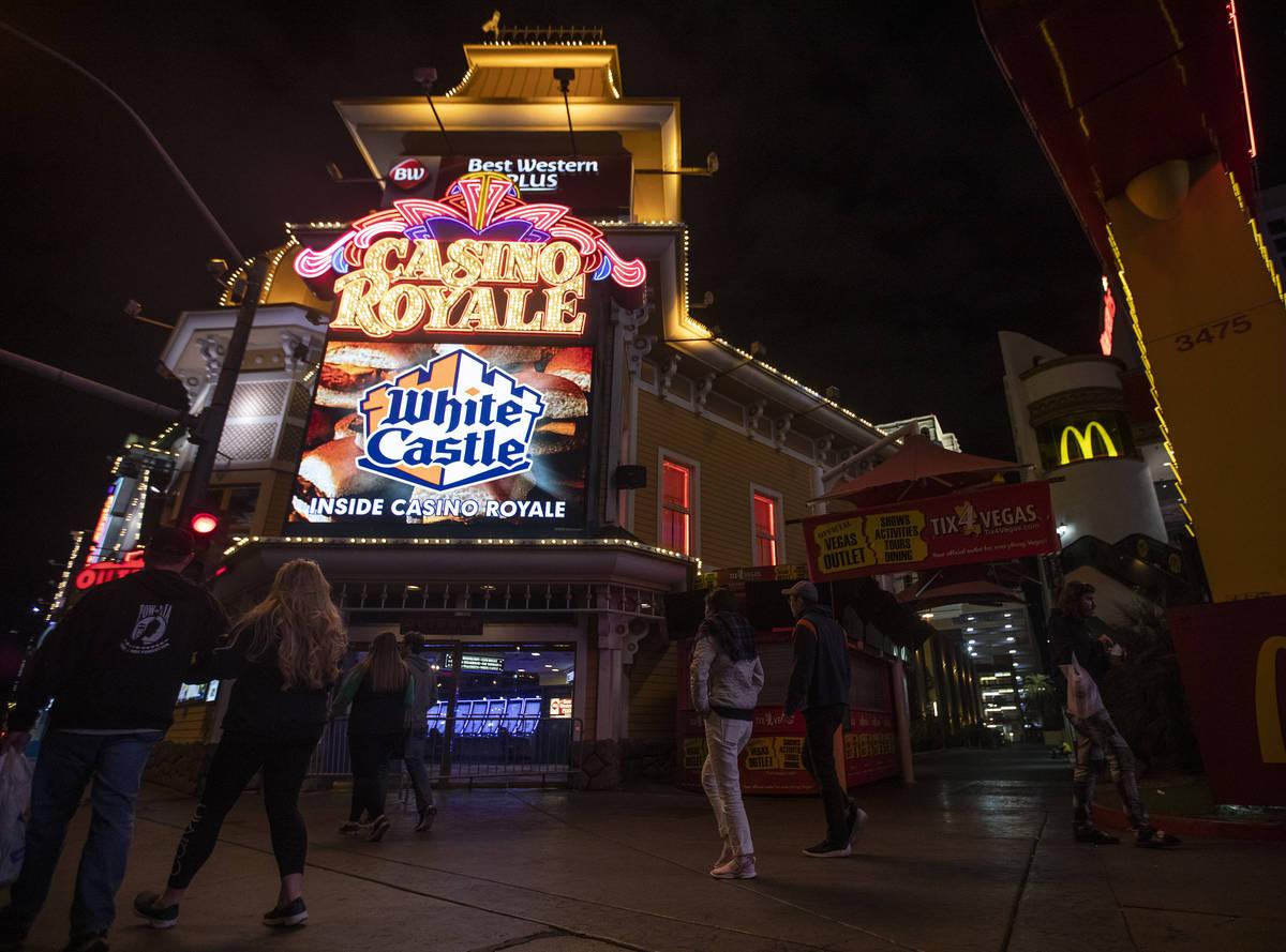 People walk past Casino Royale on the Strip on Tuesday, March 17, 2020, in Las Vegas. (Ellen Sc ...