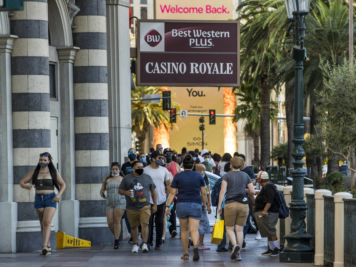 Visitors wander about the Casino Royale along the Strip on Friday, August 7, 2020, in Las Vegas ...