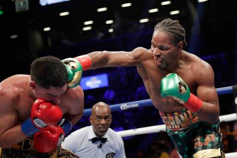 FILE - In this Sept. 8, 2018, file photo, Shawn Porter, right, punches Danny Garcia during the ...