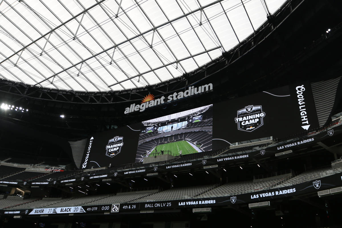 A billboard over the north end zone seating prior to a Las Vegas Raiders team practice at Alleg ...