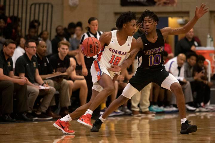 Bishop Gorman's Zaon Collins (10) dribbles past Durango's Keshon Gilbert (10) at Desert Oasis H ...