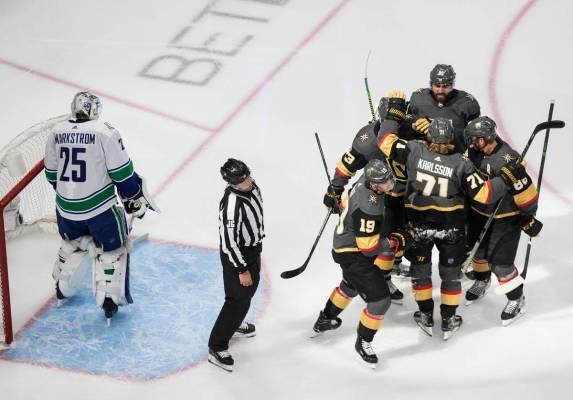 Vegas Golden Knights Celebrate A Goal On Vancouver Canucks Goalie Jacob Markstrom 25 During T Las Vegas Review Journal