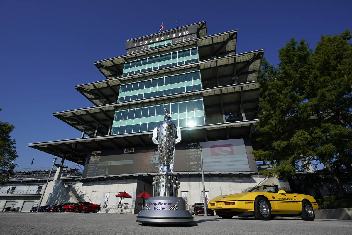 The Borg-Warner Trophy complete with a checkered flag mask, is displayed outside of the Pagoda ...