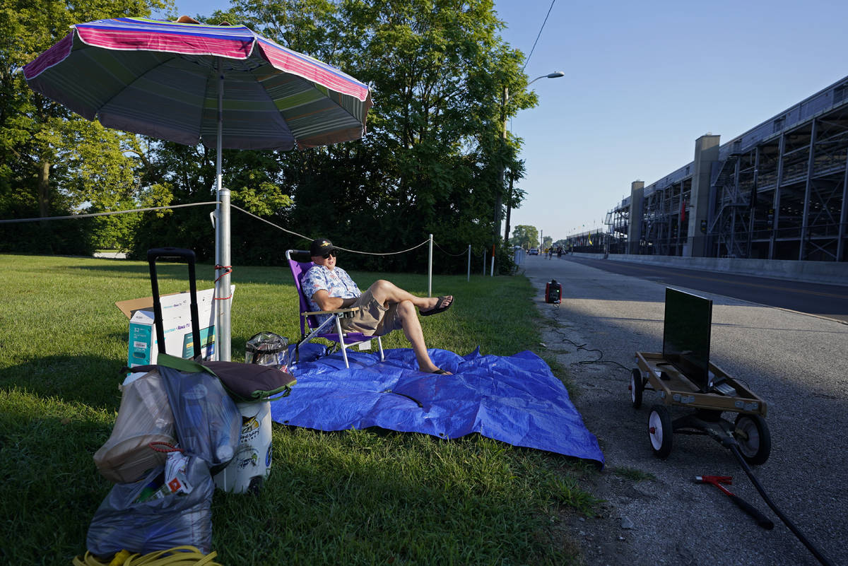 Andy Guthormsen sets up outside of the Indianapolis Motor Speedway, Sunday, Aug. 23, 2020, in I ...