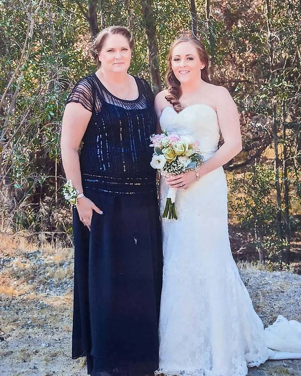 Kim Gervais, left, with her oldest daughter, Amber Manka, during Amber's wedding day in ...