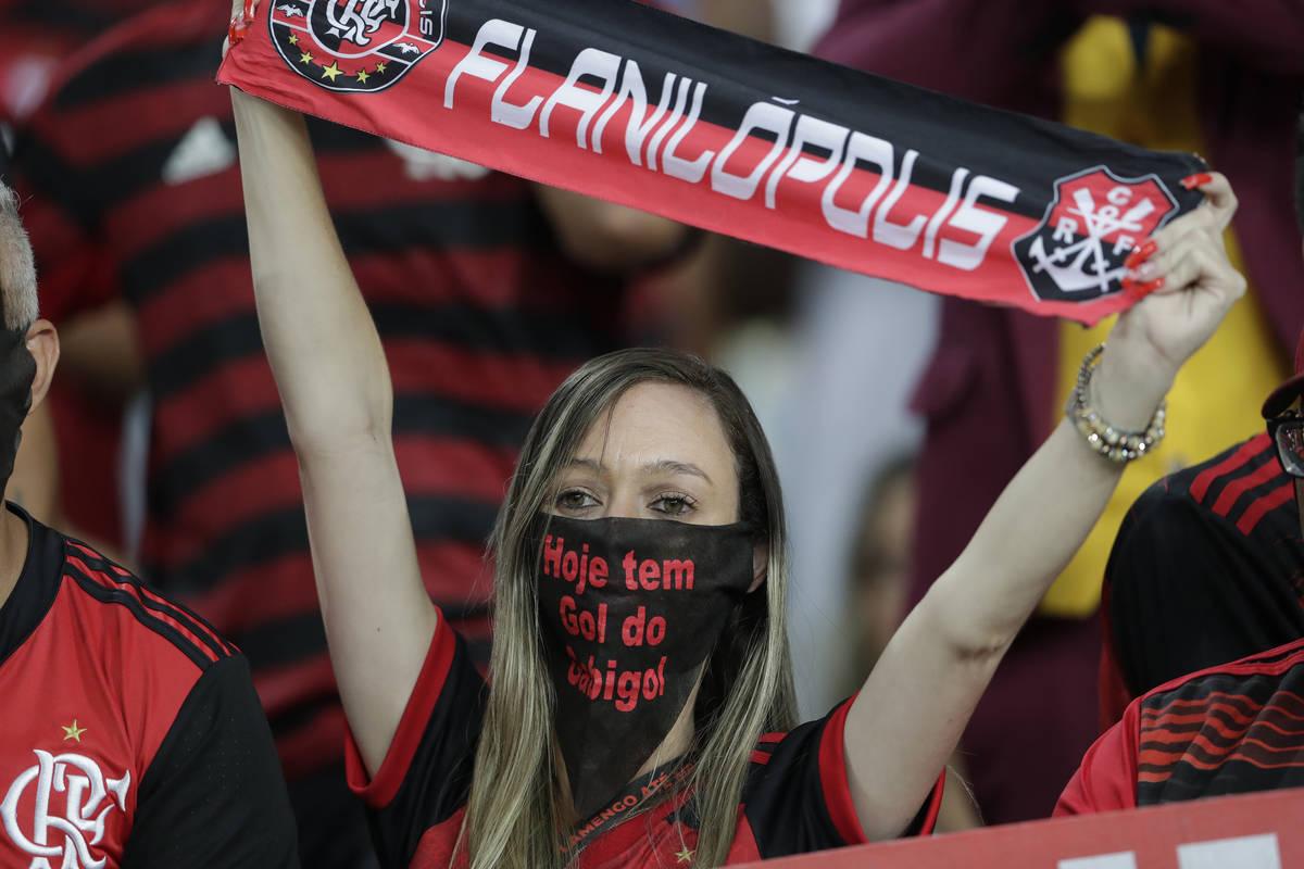 A fan of Brazil's Flamengo uses a mask before a Copa Libertadores soccer match against Ecuador' ...