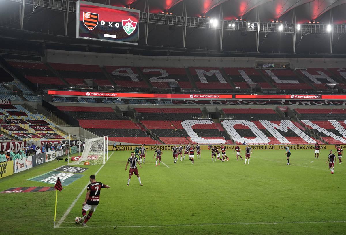 Flamengo's Everton Ribeiro, left, kicks the ball during the Rio de Janeiro state championship f ...