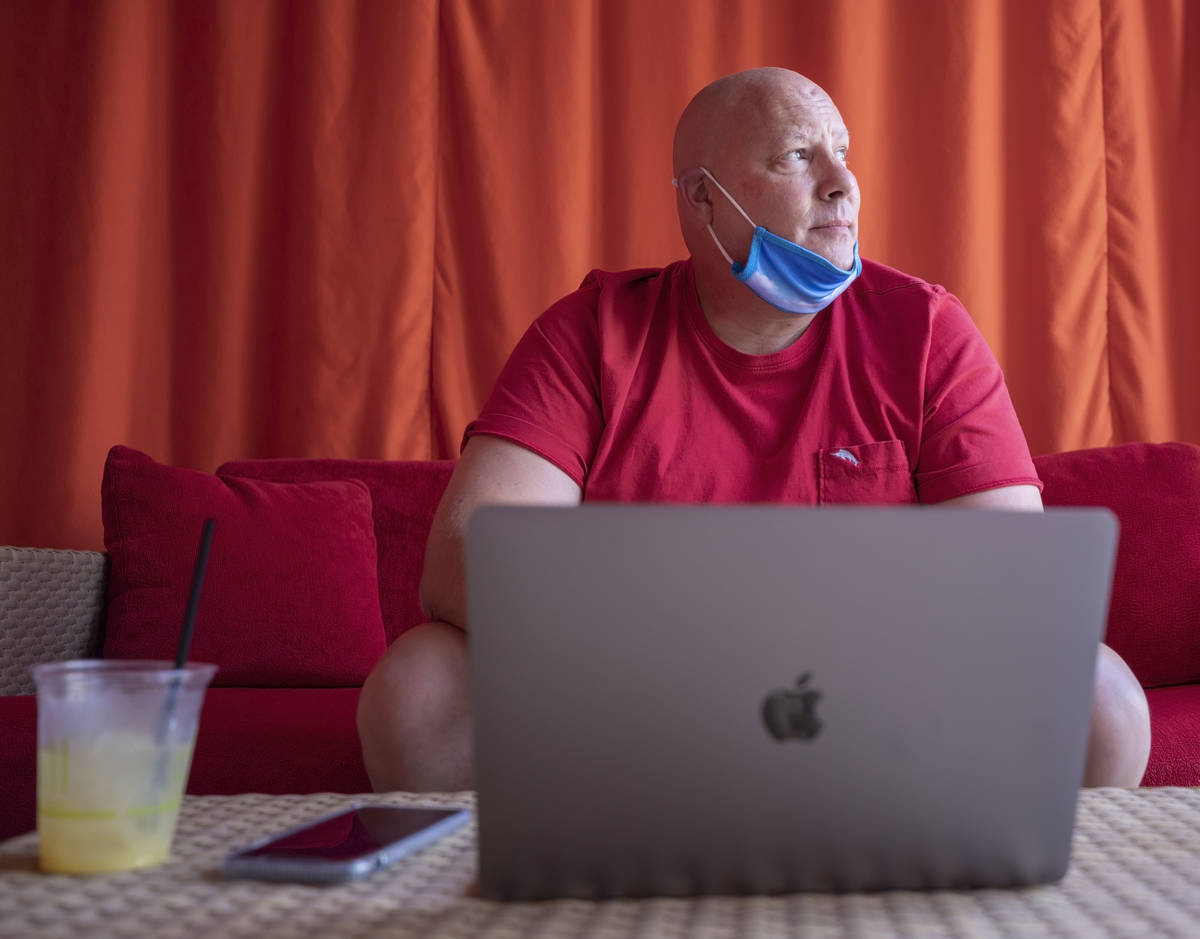 Jonathan Taylor of California works remotely in a cabana at Red Rock resort-casino on Wednesday ...